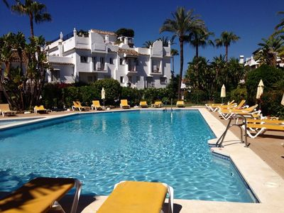 Photo for Ground floor apt 100m from the beach, large patio, direct access to the pool