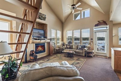 Open, charming family room with gas fireplace & views