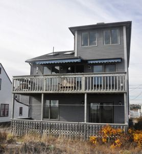 Rear of house facing beach. Living rooms on second floor for great views!
