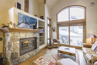 Enjoy a fire inside, or head out onto the deck for views of the skiers racing by.