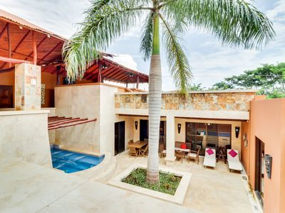 Photo for Luxury tropical villa w/ private pool & hot tub - moments away from the beach!