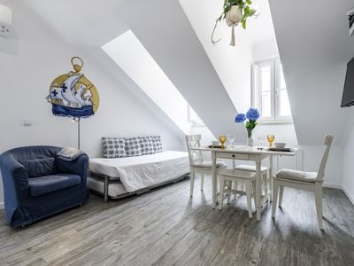 Photo for Apartment tejo view, bright, cheerful, inside the castle of lisboa