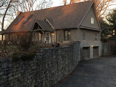Massive Stone Wall Entrance showing double wide driveway and two car garage