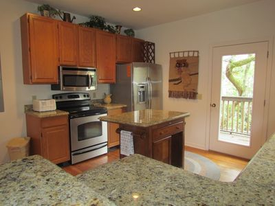 Kitchen-Updated with granite countertops and new appliances.