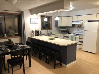 The full kitchen and dinning area.