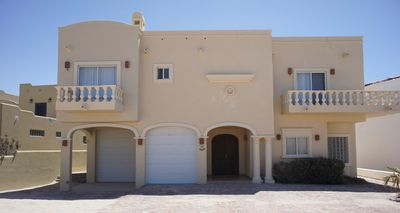 Photo for ENJOY THIS BEAUTIFUL 4 BEDROOM HOUSE IN FANTASTIC ROCKY POINT
