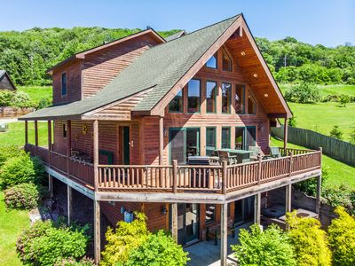 Photo for Illustrious 4 bedroom log home located in the heart of McHenry.