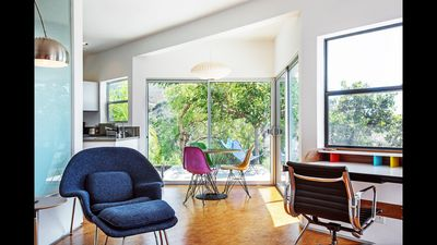 Living and dining area with Nelson,  Eames and Saarinen furniture.