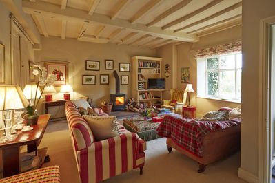 The Sitting room with SKY TV and wood burning stove