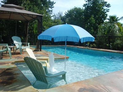 Pool with sunshelf and gazebo.