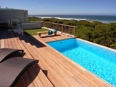 Photo for Magnificent luxury beachfront home with private beach access