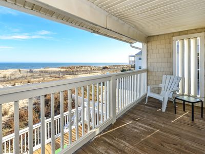 Photo for Colorful, fun 3 bedroom oceanfront townhouse with WiFi, a large covered deck, beach decor, balcony access in multiple rooms, and fantastic view of ocean located uptown in family-friendly neighborhood only a few steps to beach!