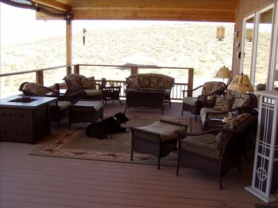 Comfortable outside furnished covered deck with deck firepit.