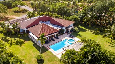 Photo for MODERN CARIBBEAN VILLA W/ HUGE LAWN, POOL, JACUZZI, GOLF CART, COOK & MAID