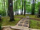 The path from the cabin to the lake, the dock and the lakeside swing