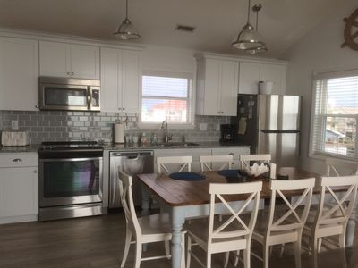 Completely Renovated Kitchen w/ dining area. Table w/ 8 chairs plus 2 additional