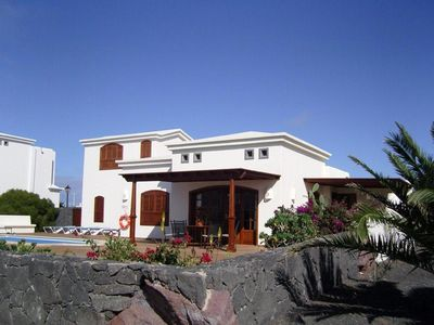 Photo for Stunning 3-bedroom villa with private heated pool, Sky TV, terrace, WIFI & A/C