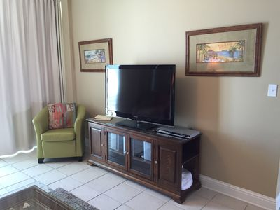 Spacious Living Room with Large HD TV, DVD
