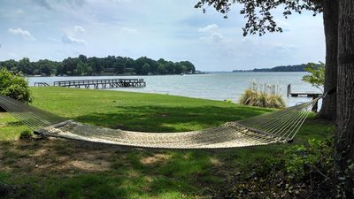 Enjoy a full acre of private property, including a beach and outdoor fireplace.