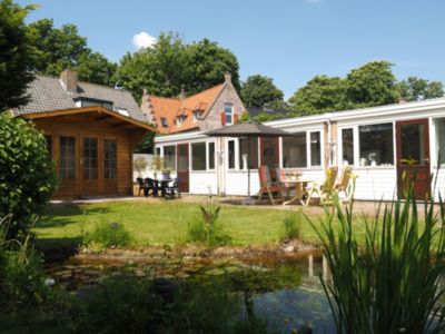 Photo for Large, ground level apartment in Egmond-Binnen. This spacious apartment (100 m²) is suitable for up