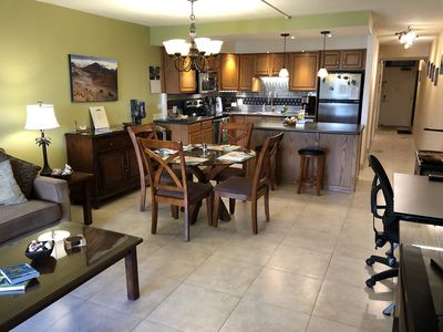 Spacious 818 square feet (76 sq m) with open design and kitchen island.
