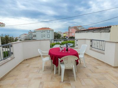 Photo for Two bedroom apartment with terrace and sea view Novalja, Pag (A-17141-b)
