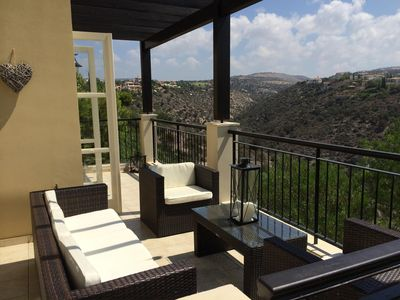Ground floor terrace with outdoor sofa set, coffee table, barbecue, dining table