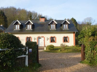 Photo for Holiday home surrounded by woods, several hiking trails, 15min. walk to sea