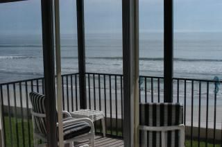 Breathtaking ocean, beach and sunrise views from condo screened-in balcony.