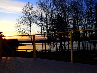 Sunrise from the new large deck with cable railing.