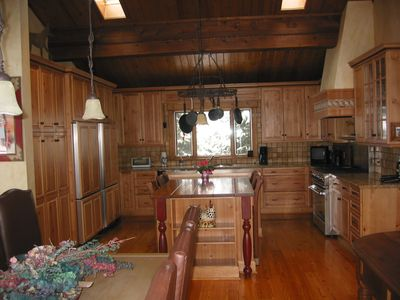 Large chef's kitchen w 2 refrigerators, pro size stove, microwave & dishwasher.