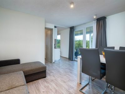 Photo for Nice apartment for 6 guests with WIFI, A/C, pool, TV, pets allowed and parking