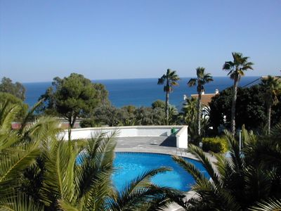 Photo for House in complex with fantastic views and swimming pool, close to the beach