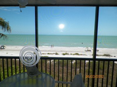 Photo for Gulf Front Beauty!  22 feet to the sand. 180 degrees unobstructed beach view.