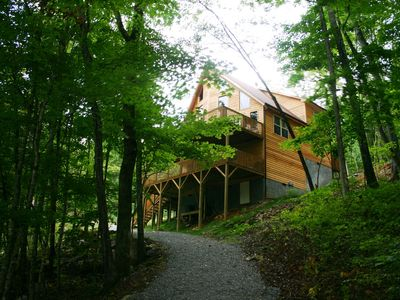 """Photo for """"Suzy Lou"""" Lakefront Getaway - covered dock, hot tub, fire pit & free kayaks"""