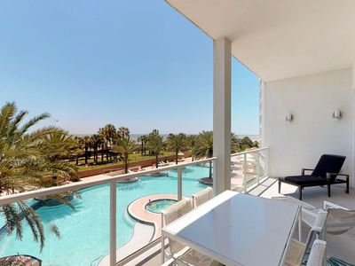 Photo for Spectacular beachfront condo w/ flatscreen Apple TV + shared pool & hot tub!