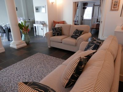 The cosy living area features two comfortable sofas.