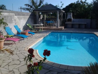 Photo for Between sea and mountain, in Creole village, large recent villa with swimming pool