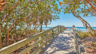 Photo for SUNSET VIEWS are waiting for you - Cozy cottage in Indian Rocks Beach just 30 steps to the beach.   Free Wifi and cable!