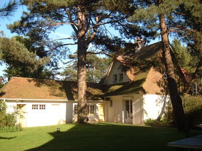 Photo for Charming villa on large sunny ground in the pine forest between sea and golf