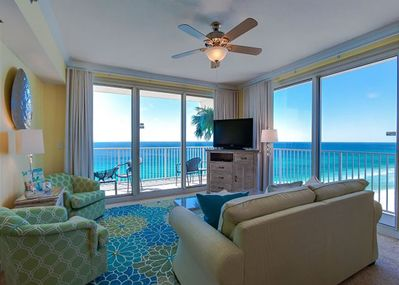 wrDual sliding doors to access the wraparound balcony with ocean and sunset view