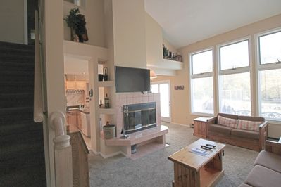 Main living room, view to kitchen.