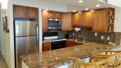NEW CHERRY WOOD CABINETS WITH GRANITE COUNTERS