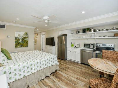 Photo for Tropical Breeze Resort - Studio w/ Full Kitchen. Located in Siesta Key Village. Short Walk to Beach. INCLUDED: Daily Housekeeping, Bikes, 2 Pools/1 Spa, Beach Chairs, Beach Towels, WiFi, Parking , Games, BBQs and More!