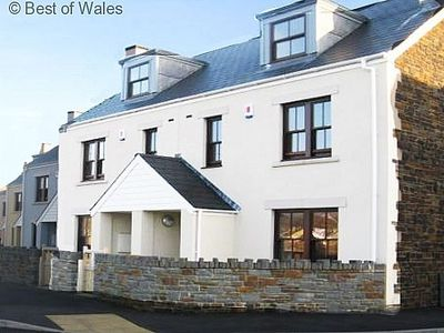 Photo for Harbourside cottage, short walk to the beach and golf course nearby