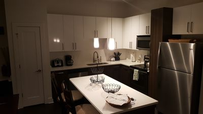 Kitchen w/2seat Island, coffee maker, 4 slice toaster, blender, cookware, dishes