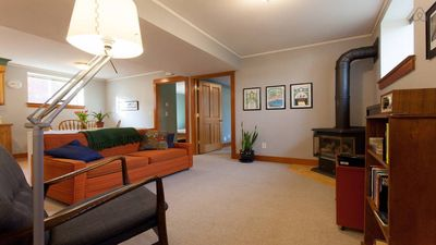 Living room with gas fireplace, TV, and couch with pull-out double bed.