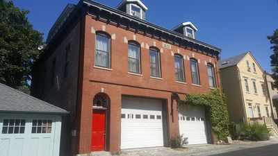 Photo for FIREHOUSE UNIT #1 - Downtown , walk to water, parking, d'eck and extra bed