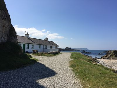Photo for Beautiful seafront cottage, extensive private gardens, stunning sea views.