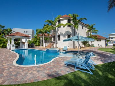 Photo for NEW LISTING! Elegant, waterfront home w/ private pools & dock - walk to beach